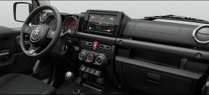 Infoskærmen er meget moderne, men ellers er Jimny indrettet med greb og knapper, der kan betjenes med luffer på.